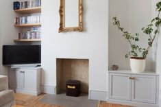 Alcove cupboards painted light grey to match the skirting boards and contrast with the white walls & reclaimed pine shelving Alcove Storage, Alcove Cupboards, Off White Walls, 1920s House, Home Board, Home Fireplace, Lounge Decor, New Room, House Colors