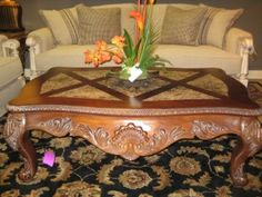 Price: $185.95  Item #: 123904 Carved wood coffee table with center marble top. Matching end table available at time of posting.