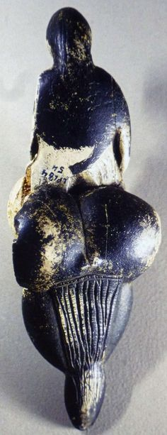 The 'Lespugue Venus' is a figurine, a statuette of a nude female figure from the Gravettian period, dated to between 26 000 and 24 000 years ago. It was discovered in 1922 in the Rideaux cave of Lespugue (Haute-Garonne) in the foothills of the Pyrenees by René de Saint-Périer (1877-1950). Approximately 6 inches (150 mm) tall, it is carved from tusk ivory, and was damaged during excavation. Lespugue Venus, back view (photo: Leroi-Gourhan, 1982; Musée de l'Homme, Paris)