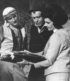 """Elvis on the movie set of """"Harum Scarum"""" with Director Gene Nelson & another staffer. Nelson  also directed the Elvis Presley film """"Kissin' Cousins"""" (1964). He co-wrote the """"Kissin' Cousins"""" screenplay for which he received a WGA award nomination for best written musical."""