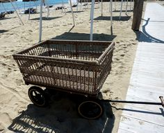 wicker basket wagon. Would be so cool filled with plants.