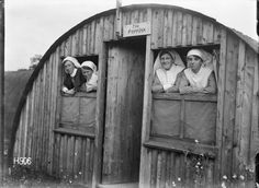 Four nursing sisters look out of the windows of the New Zealand Stationary Hospital, Wisques, France