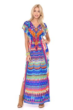 Luli Fama Caftan 2016 | If you start hearing whispers as you walk by, take it as a compliment because this rich Luli Fama Tribal Beach Caftan is jaw dropping gorgeous. #lulifama