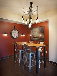 This casual dining space incorporates modern colors and decor while emanating an overall rustic, warm feel. The Arts & Crafts chandelier adds an eclectic touch.