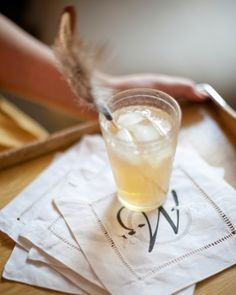 Feathered swizzle sticks and monogrammed linen napkins