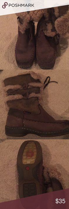 Brown suede winter boots Super cute, only worn occasionally on ski trips. Water resistant - we're fine walking round ski town but wouldn't wear in rain.  They are a 7.5 but I feel they fit more like a 7. biondo Shoes Winter & Rain Boots