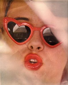 Lolita! Loving these heart shaped sunnies and red lips!