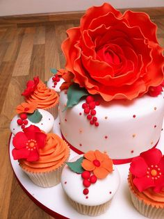 Red and orange cake and cupcakes