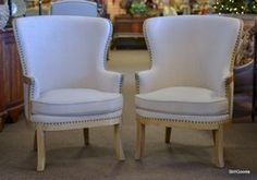 Pair of deconstructed wingback style club chairs with bleached wood frames, linen tone upholstery. Brand new on consignment by designer. www.stillgoode.com
