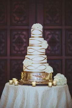 WEDDING CAKE with Gold Details | See the wedding on SMP: http://www.StyleMePretty.com/southeast-weddings/2014/02/28/traditional-wedding-at-the-breakers-palm-beach/ Jonathan Connolly Photography