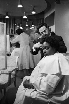 Winifred has her hair straightened out at her salon in Brixton, 1957.