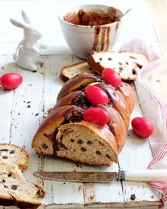 Packed with chocolate chips and topped with candy-coated Easter eggs, this tsoureki is a fun twist on the traditional Greek Easter bread. Greek Easter Bread, Steak And Kidney Pie, Bread And Butter Pudding, Egg Wash, Dried Cranberries, Salted Butter, Dry Yeast, Melting Chocolate, Good Food