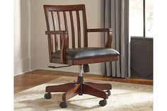 Wassner home office swivel desk chair proves there is beauty in simplicity. Straight lines and a warm finish make for a simply stunning piece. Easy-care faux leather covers the amply cushioned seat.
