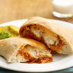 BBQ Chicken Calzones - use pre-made pizza dough, shredded chicken with BBQ sauce and mozzarella to make this dish in under 20 minutes.