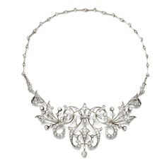 DIAMOND TIARA / NECKLACE, CIRCA 1890, Of open work acanthus and scroll design set with circular-cut and rose diamonds, to a back chain of knife-edge linking highlighted at intervals with circular-cut stones, length approximately 360mm, necklace detachable, tiara frame deficient.