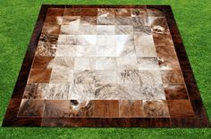 Shiny patchwork cowhide area rug. Brindle, tiger, awesome!