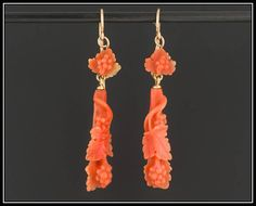 Grapes and grape leaves symbolize a bountiful harvest and a celebration of life. Grape jewelry is also worn by some to represent the presence of Christ, since wine is believed to transform into or symbolize Christs blood.  These outstanding hand carved coral drop earrings (circa 1860-1890) depict grapes and grape leaves. They are beautifully rendered and set on 10k gold ear wires (not original to the earrings).  The earrings measure 1.85 inches from the top of the ear wire to the bottom by…