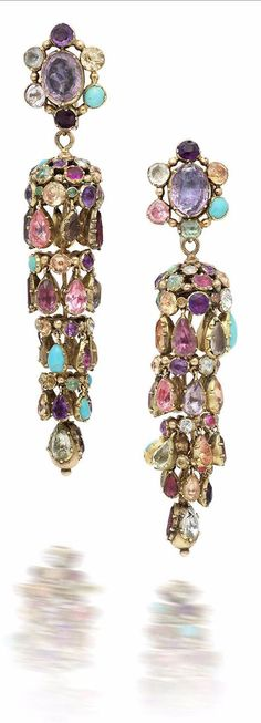A pair of 19th century multi gem-set earrings. Each cluster surmount suspending a highly articulated cascade drop, terminating in a beaded finial, collet-set throughout with multi-coloured circular, oval and pear-shaped gemstones, including turquoise, topaz, amethyst, emerald and garnet, all in closed-back gold settings, length 7.5cm, fitted cased by Wartski Ltd, 138 Regent Street, London, W1 and Llandudno