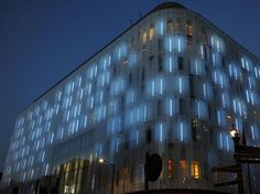 The façade artwork designed by Jason Bruges Studio for the W Hotel in London's Leicester Square responds to changes in the weather and activity around it by recording the surrounding skyline and translating the images into an animation played out at night on hundreds of lights concealed behind the translucent cladding.