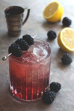 The Bramble - Gin, Lemon Juice Simple Syrup, Crème de Mûre, Blackberries.