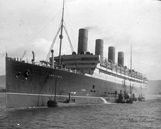 """RMS Aquitania was a Cunard Line ocean liner designed by Leonard Peskett and built by John Brown & Company in Clydebank, Scotland. She was launched on 21 April 1913 and sailed on her maiden voyage to New York on 30 May 1914. Aquitania was the third in Cunard Line's """"grand trio"""" of express liners, preceded by the RMS Mauretania and RMS Lusitania, and was the last surviving four-funnelled ocean liner."""