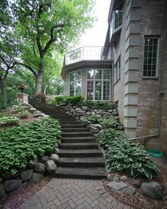 Alongside paths and steps on challenging shady slopes, consider rugged groundcovers like lily-of-the-valley, ginger, sweet woodruff, spotted lungwort and cinquefoil.