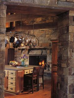 Can use stone for the walls in the kitchen. And, a fireplace too? Yes, please.