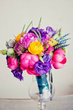 Beautiful! We are loving these bright colors in florals! Bouquet via Mix and Chic.
