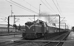 A engine pulling an express train through Tikkurila, late Diesel Engine, Trains, Engineering, History, Historia, Mechanical Engineering, Technology, Train