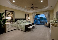 Stunning master bedroom with balcony overlooking sparkling lakes at Bonita Lakes, Florida. Cozy Bedroom, Master Bedroom, Bedroom Decor, Master Suite, Bedroom Ideas, Bedding And Curtain Sets, Affordable Bedding, Luxury Bedding Sets, New Homes For Sale