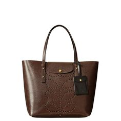 Orla Kiely: Textured leather unlined bag with punched stem detail on the front.