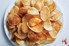 Keys to great potato chips: A lower frying temp gets the moisture out; a vinegar soak ensures they're crisp.