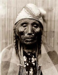 Here for your browsing pleasure is a grand photo of a very old Indian Woman. It was made in 1910 by Edward S. Curtis in Washington State.    The photo documents a Head-and-shoulders portrait of of the Indian woman with bone through her nose.    We have compiled this collection of photos mainly to serve as a vital educational resource. Contact curator@old-picture.com.    Image ID# 2F01E876
