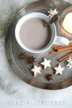 winter tray. Fill with white books, white mug, and snowflake ornaments for decoration.