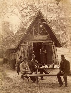 People at the hermit hut, from the 1820s, in Rydboholms Castle English park. The castle dates from the 1400s.  http://www.europeana.eu/portal/record/91622/01F876DCBC359B0EE362B9E010AE0841722317B3.html