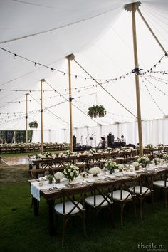 Gorgeous Lake Tahoe wedding reception Sailcloth Tent + Market Lights + Farm Tables + Crossback Chairs + Wood Grain Dance Floor | Celebrations! Party Rentals and Tents | Photo by Theilen Photography | Event Styling by Cloud Nine Event Company