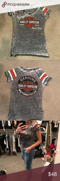 Harley Davidson Burnout tee Oil can burnout tee. Perfect condition. Worn twice. 60% cotton 40% polyester. V neck.  Printed graphics with rhinestone embellishment. Contrasting stripes on sleeves. Harley-Davidson Tops Tees - Short Sleeve