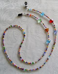 Items similar to Eyeglasses Glasses Chain Holder Beaded Colorful Necklace Handmade on Etsy Eyeglasses Glasses Chain Holder Beaded Colorful by DitzasShop Seed Bead Jewelry, Jewelry Making Beads, Beaded Jewelry, Beaded Necklace, Beaded Bracelets, Bracelet Crafts, Jewelry Crafts, Waist Jewelry, Beaded Lanyards