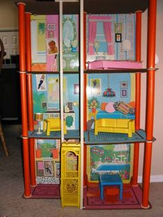 Barbie Townhouse! With the elevator powered by a string- played with neighbor April when i would go over to her house as a preteen. played with this for hours