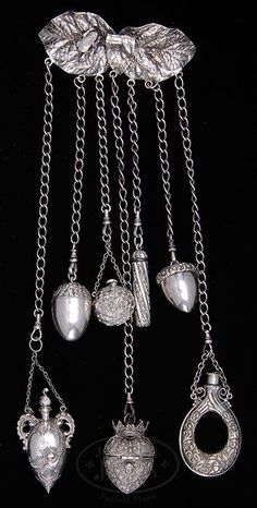 Lot 2278. STERLING SILVER CHATELAINE. (65272)