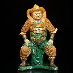 Large and Rare Ming Dynasty Roof Tile Figure. Chinese, Ming Dynasty. A massive ridge tile in green, amber, and yellow glaze depicting a high ranking warrior. These tiles were arranged along imperial ridges and reserved for the most important buildings. Ht. 22 in.