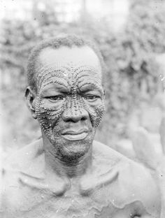 Africa | A Mbuja man, from the DR Congo, with typical facial scarifications. Each series of scarifications has a specific name and is introduced at various times. This is an example of a completed series of scarification. | © Auguste M. Bal