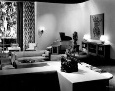 THE MOVIE SETS OF MGM,  The Nick and Nora Charles' living room had huge picture windows, a particular architectural feature favored by Art Director Cedric Gibbons, which he had in his own stunning Art Deco house in West L.A. The living room has a coffee table in front of the sofas, a new interior design feature at the time.