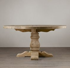 RH's Salvaged Wood Trestle Round Dining Table:Handsomely distressed, our table is crafted of substantial pine timbers and supported by a hand-turned pedestal leg.