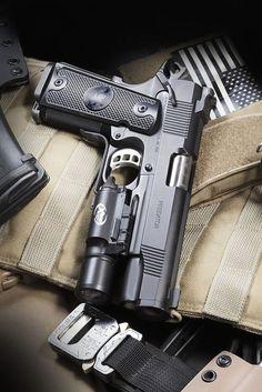 Nighthawk Custom M1911A1 Semi-Auto Handgun Cal .45ACP With a Surefire X300 Tactical Light