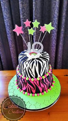 Super fun birthday cake for a 10 year old girl! Love the bright colors.. and of course the zebra print (love love love zebra print!) | by cakedcreations