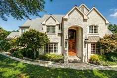 2626 Hemingway Drive, Arlington, TX | $2,750,000 | 6 Bed | 6 Bath | 9,299 sqft. European custom home nestled on quiet tree-lined street, sits on approximately 2 acres. Home showcases five bedrooms in main home, four living areas, wine cellar, 5-car garage with part HVAC temperature control storage, back yard oasis with outdoor living area, guest house, cabana, pool, sport court, and extensive landscaping with tiered sitting areas overlooking creek/waterfall.