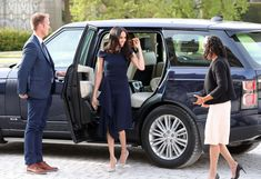 Meghan Markle Wears a Navy Roland Mouret Dress Ahead of Her Wedding