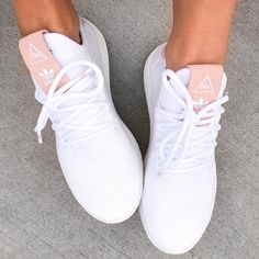 adidas Originals Pharrell Williams Tennis Hu in raw pink and white. Seriously stylish sneakers.