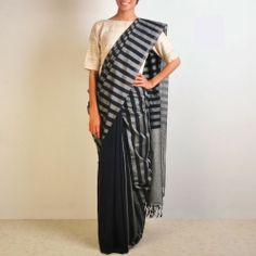 Grey and Indigo Handwoven Cotton Sari  This half plain & half stripe handwoven sari in grey and indigo color is a perfect wear for every age group woman. Be it office or college, the sari gives very chic & classy lift to once personality. Shop here: http://www.tadpolestore.com/reubenbright-clothing #clothing #saree #handwoven #cotton